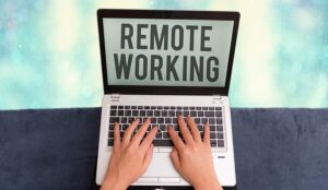 A picture of a laptop with the words remote working