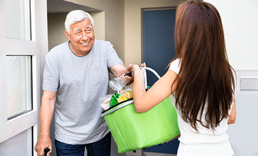 A picture of a shopping delivery to an elderly customer