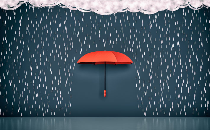 A red umbrella is sourounded by drawings of rain falling from a cloud