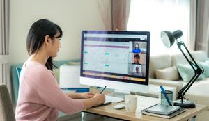 A woman is on a video call, working from home