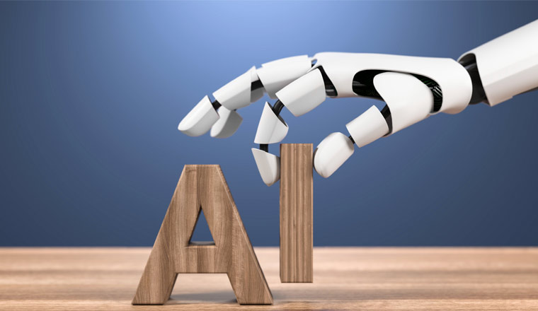A picture of a robots hand holding the letters a and i