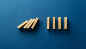 A picture of an outlined figure stopping wooden battons from falling