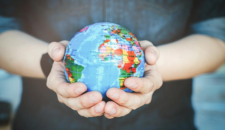 A photo of a globe in someone's hands
