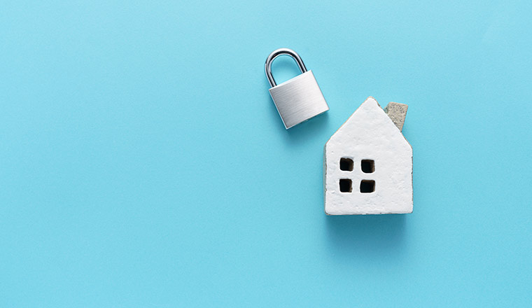 A picture of a house and a padlock