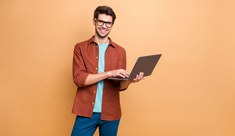 A photo of someone holding a laptop
