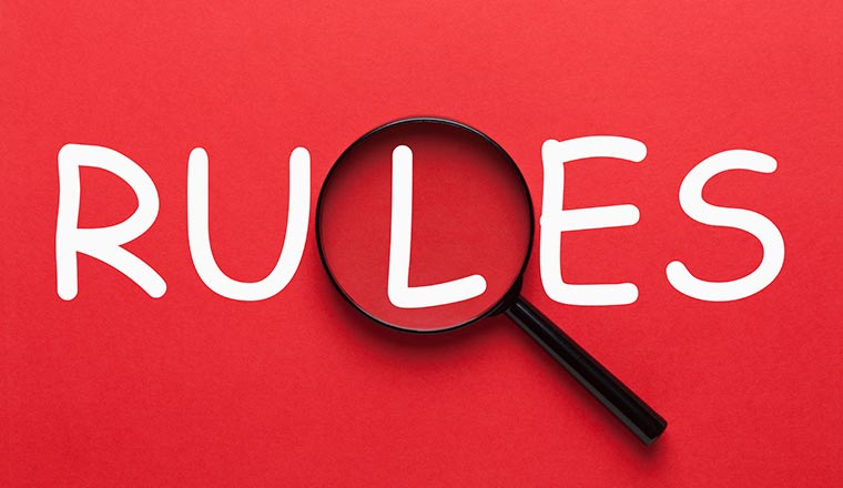 "A picture of the word ""rules"" on a red background"