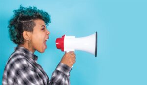 A picture of a person shouting into a megaphone