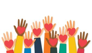 A picture of hands raised up with red hearts