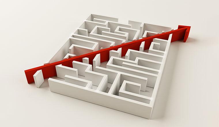 A photo of an arrow through a maze