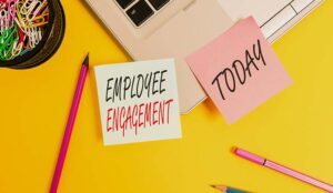 """A photo of a post it note with the words """"employee engagement"""""""