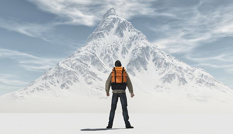 A photo of a man versus a mountain
