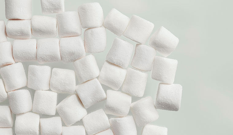 A photo of white marshmallows