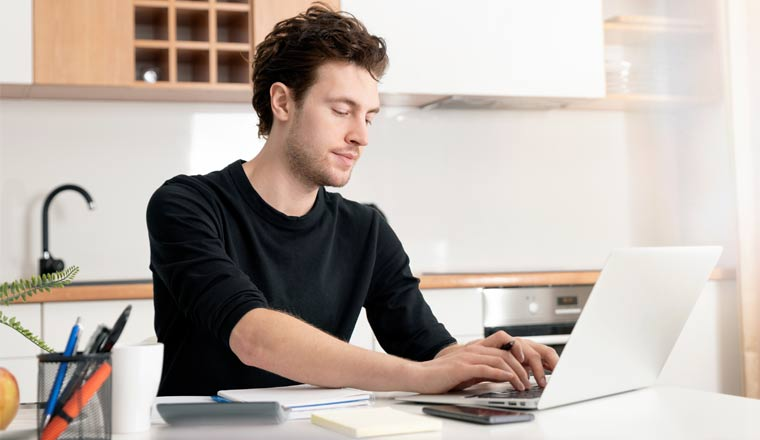 A picture of an agent working at home on a laptop