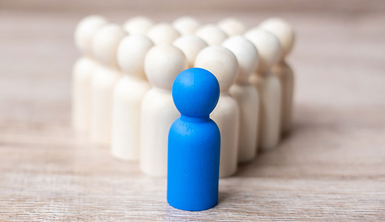 A picture of a blue figurine leading a group
