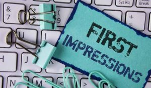 A picture of text First Impressions a keyboard and paper clips