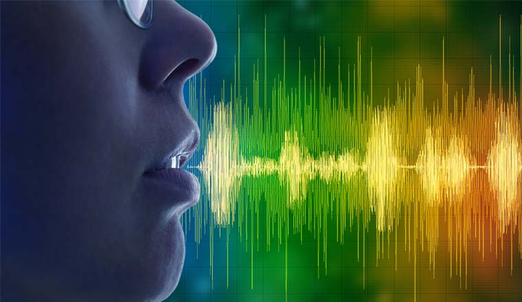 A picture of a person speaking and sound waves