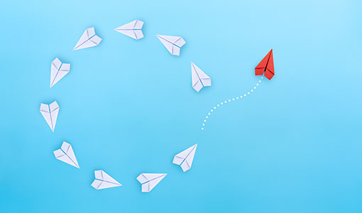A picture of paper planes circling indicating change