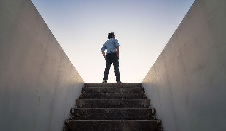 A picture of someone climbing stairs to the future