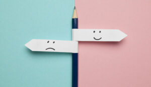 A picture of a happy and sad signpost