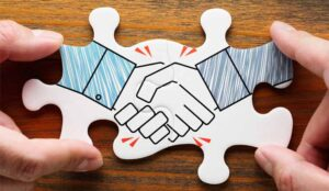 A picture of a puzzle picture of a hand shake