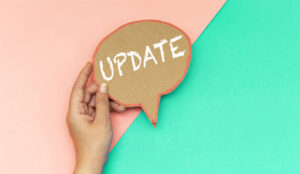 A picture of a cut out speech bubble with the words update