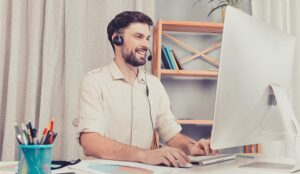 A photo of a call centre agent listening