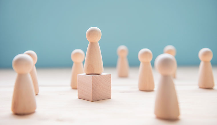 A photo of a pawn on a wooden block (leadership concept)