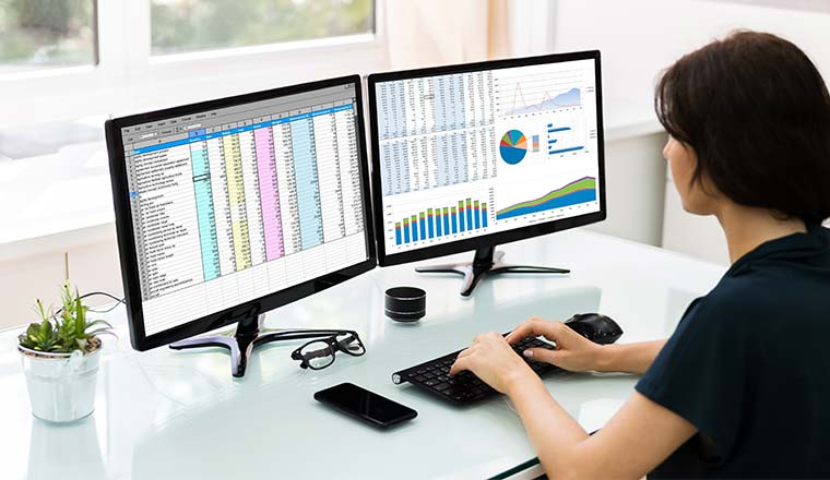 A photo of someone working with spreadsheets