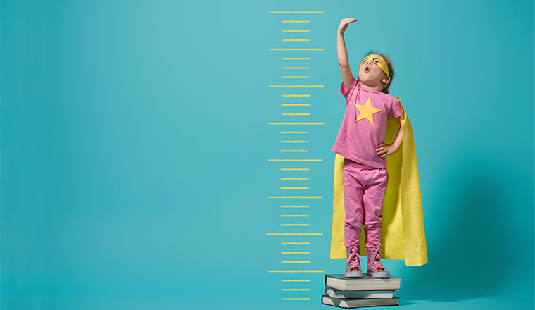 A photo of a superhero child trying to grow taller