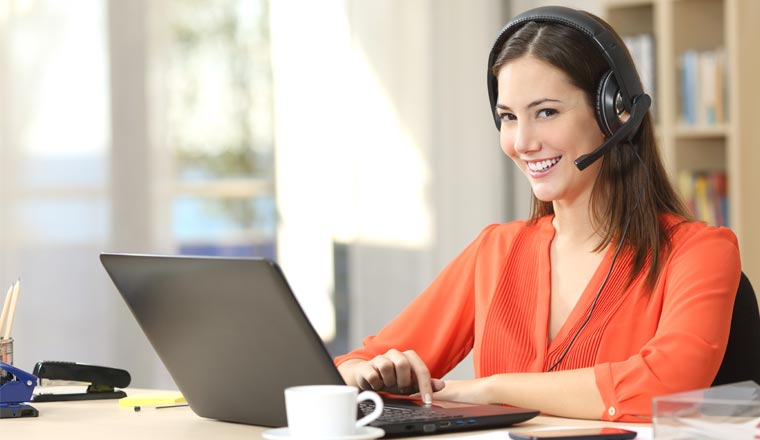 A picture of an customer service agent working from home office
