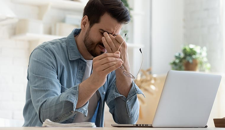 A photo of a fatigued remote worker