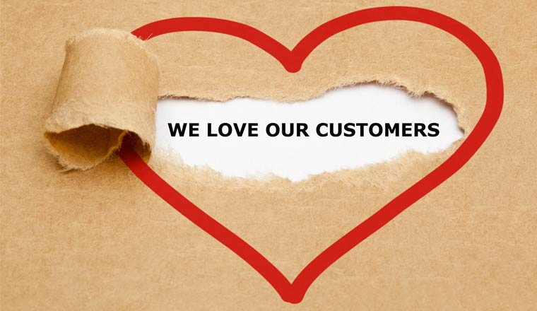 A picture of a heart with the words we love our customers