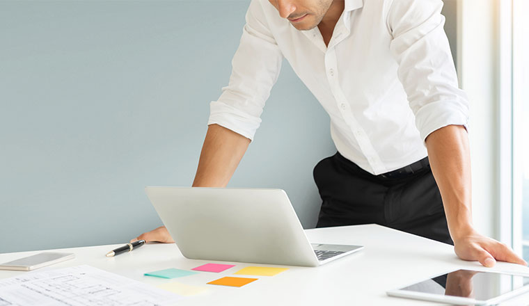 A photo of someone planning at their laptop