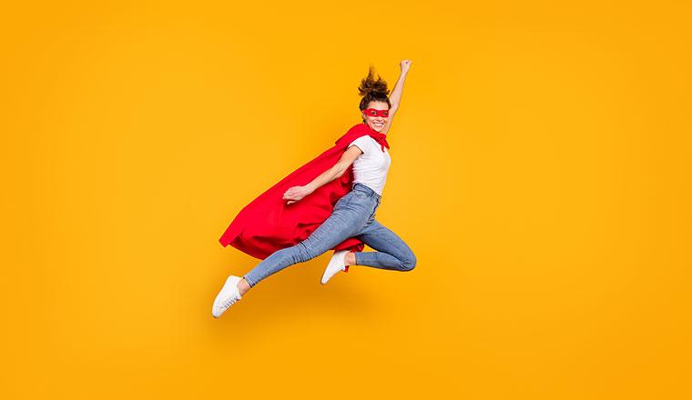 A photo of a superhero jumping