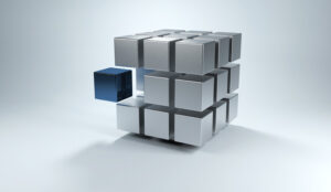 A picture of a 3D cube with sections in gray and one in blue