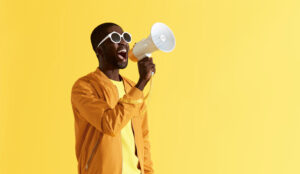A picture of a man shouting into a megaphone