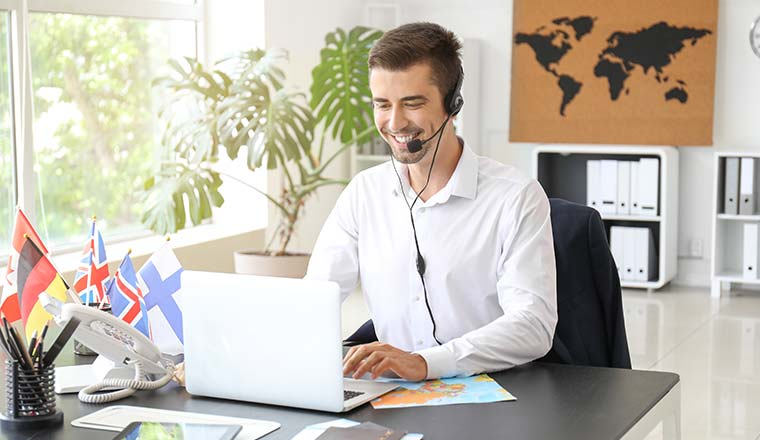 A photo of a call centre agent working at a travel agents