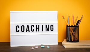 A photo of a coaching sign