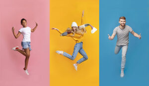 A photo of happy people jumping