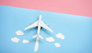 A picture of a passenger plane with clouds