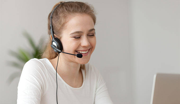 A photo of a smiling remote agent