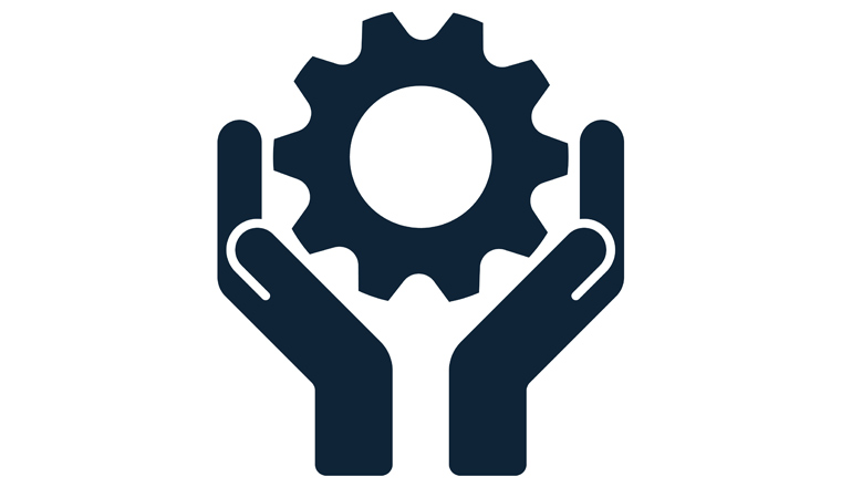 A picture of hands supporting a cog