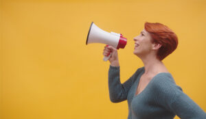 A picture of a lady holding a megaphone