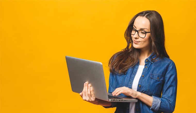 A picture of a lady holding a laptop