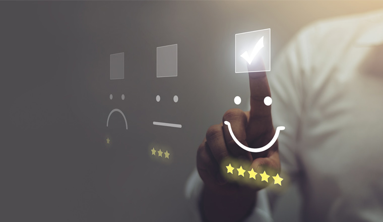 A picture of a person selecting a star rating on a touch screen