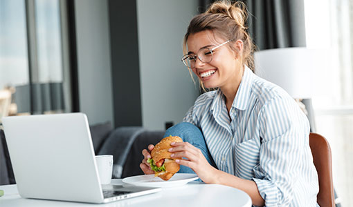 A photo of someone eating a burger online webcam