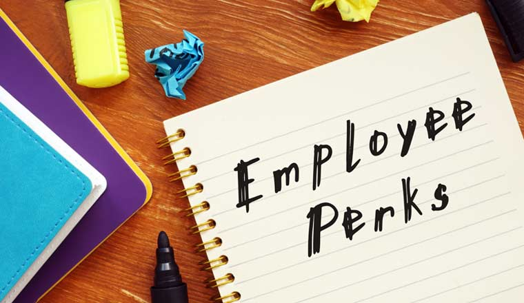 A picture of a note pad with the words employee perks