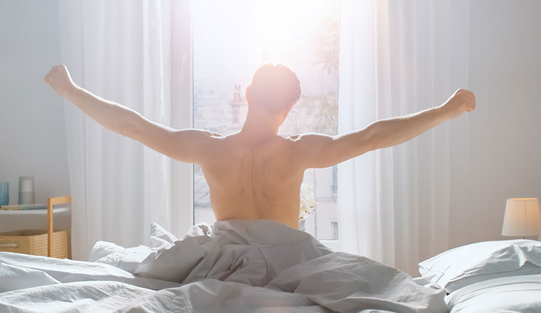 A photo of someone getting out of bed
