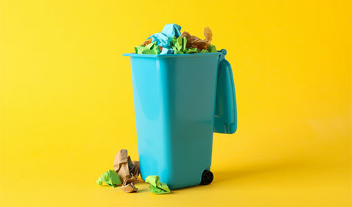 A picture of a overfilled bin