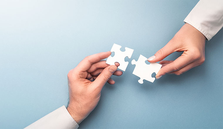 A photo of putting puzzle pieces together